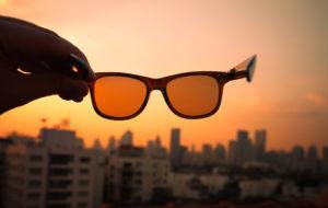 sunglasses against a sunset