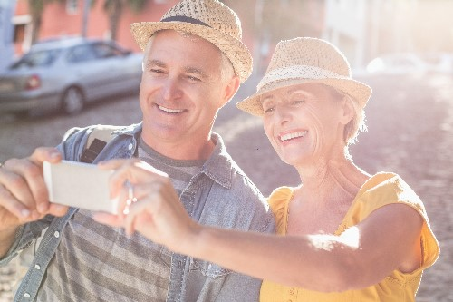 Cataract-aged Couple Looking at Mobile Phone