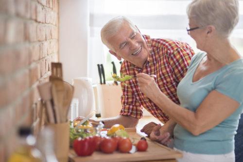 Older Couple Preparing Salad