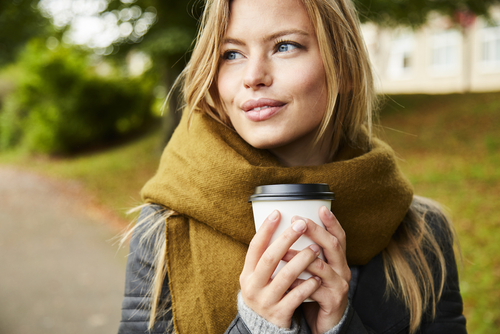 Smiling Young Woman Holding Coffee