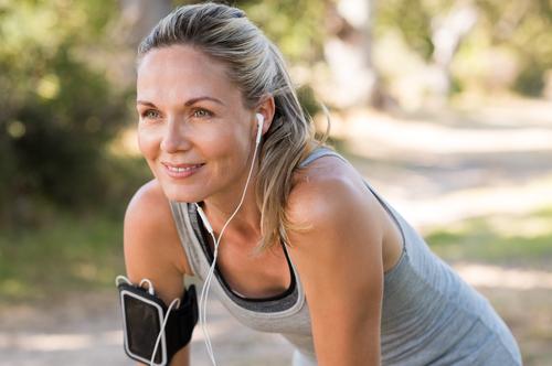 Woman Pausing During Run