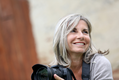 Woman with Camera, Smiling