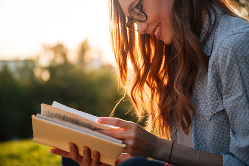 Young Woman with Glasses Reading Book