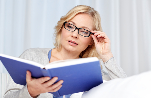 Woman Using Glasses to Read