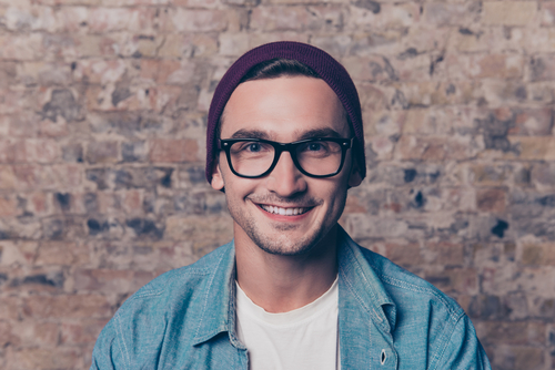 Smiling Young Man with Glasses