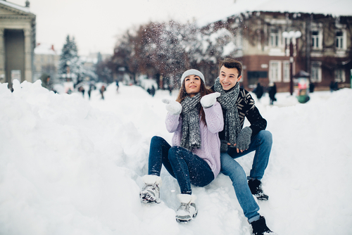 Young couple frolicking in the snow