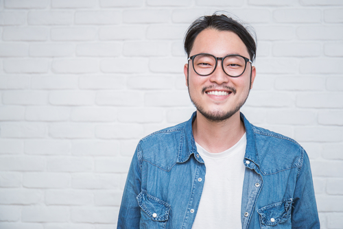 Man smiling in front of camera