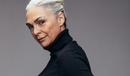 older woman in black turtle neck