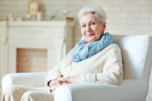 older woman sitting on couch