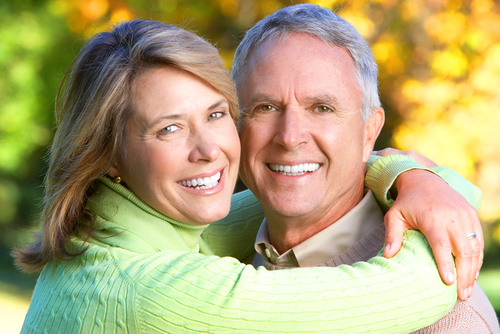 older man and woman smiling for photo