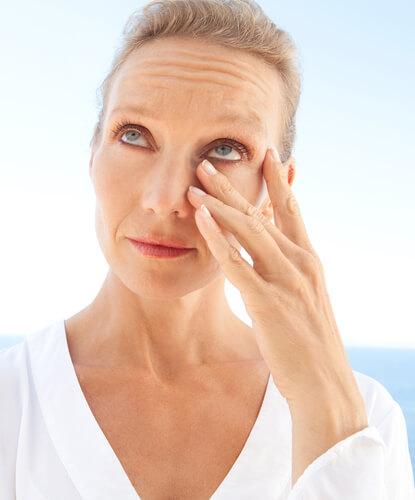 woman rubbing her eyelids