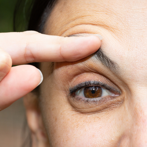 Close up of person measuring eyelid