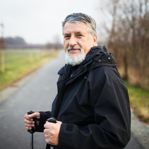 Senior man with walking sticks